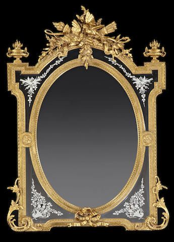 A Louis XVI style giltwood and engraved glass mirror,fourth quarter 19th century.