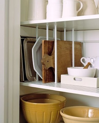 Storing awkward items with tension rods...love it!