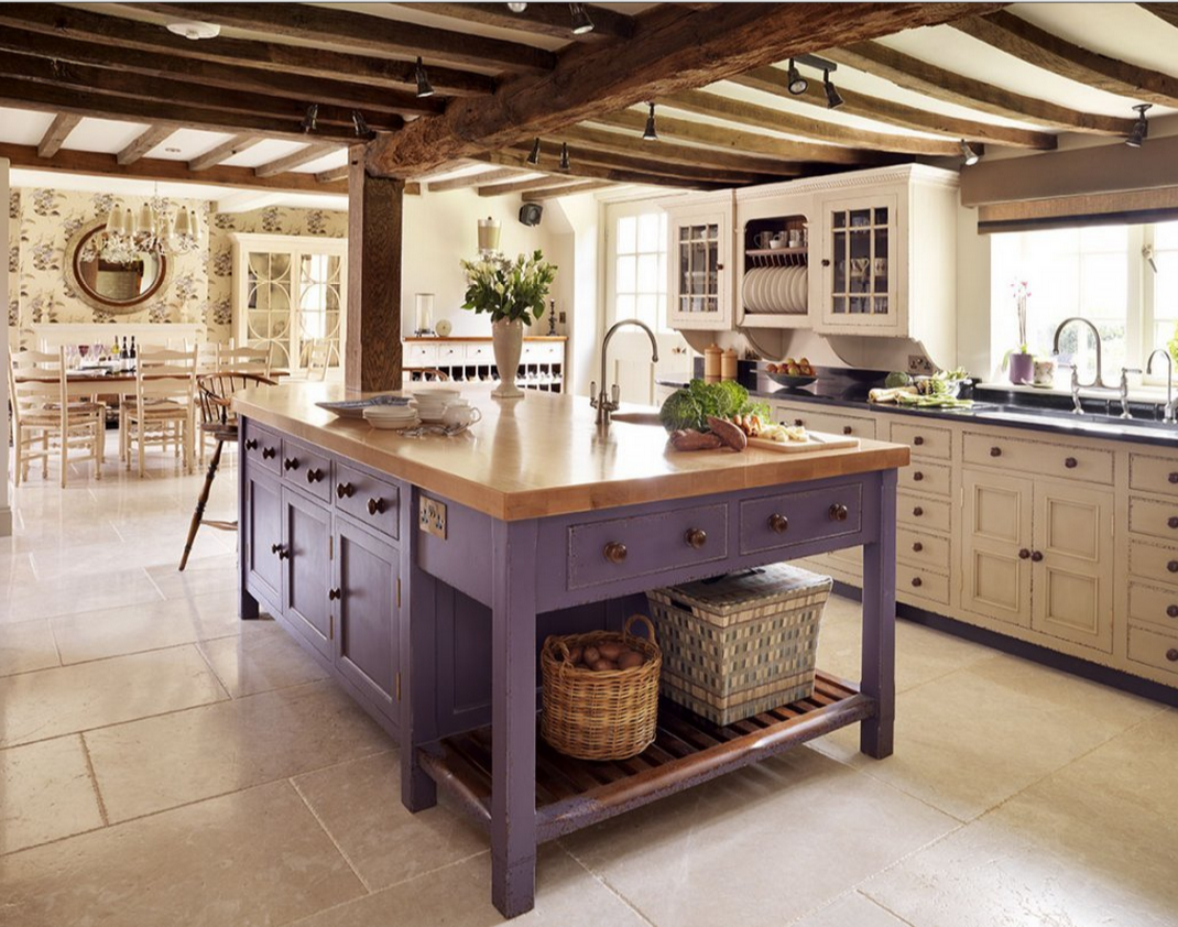 Butcherblock top on a purple rustic kitchen island table set in the ...