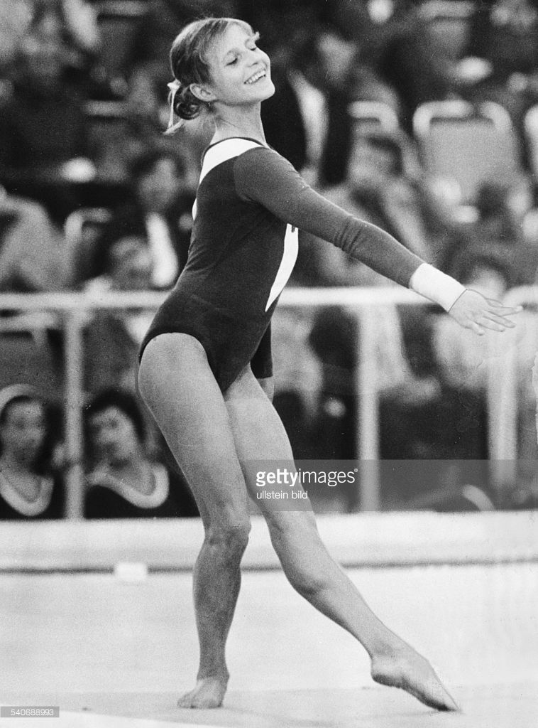 olga korbut she brought a smile to anyone who saw her perform and made gymnastics
