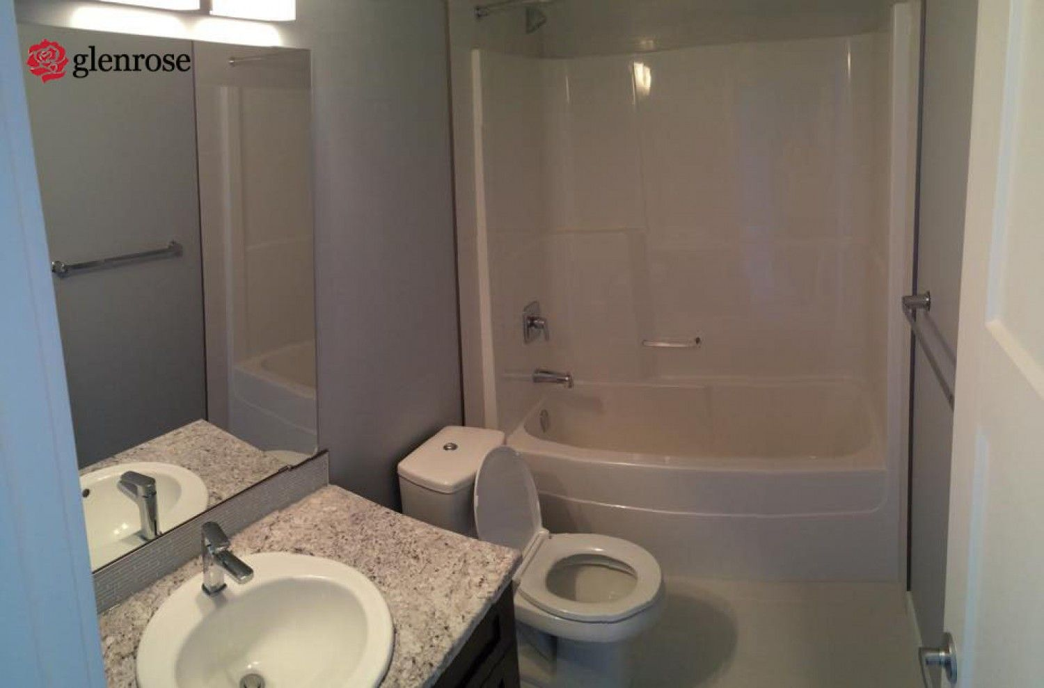 bathroom with granite countertops and backsplash at 4502 Delhaye Way, in Harbour Landing