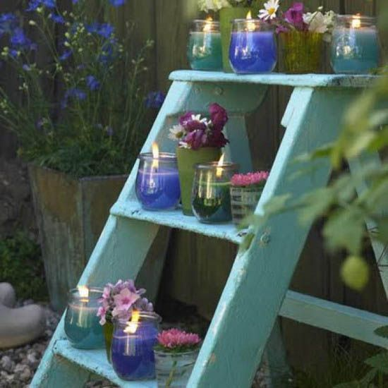 Painted wooden stepladder as a display for candles plants cut
