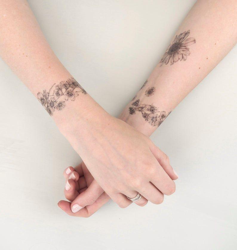 Pin By Jacinta On Tattoos In 2020 Daisy Chain Tattoo Chain Tattoo Tattoo Kits