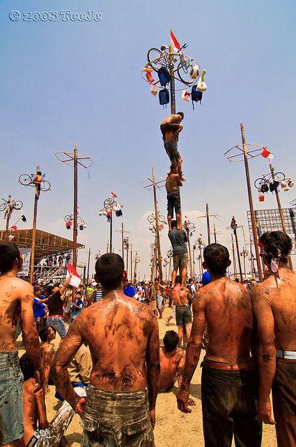 lomba panjat pinang (pole climbing competition), Indonesia