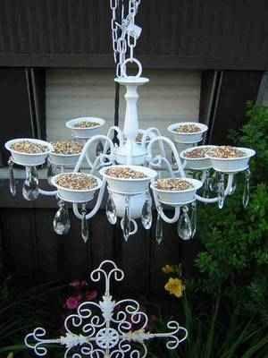 Repurpose an old chandelier as a bird feeder.