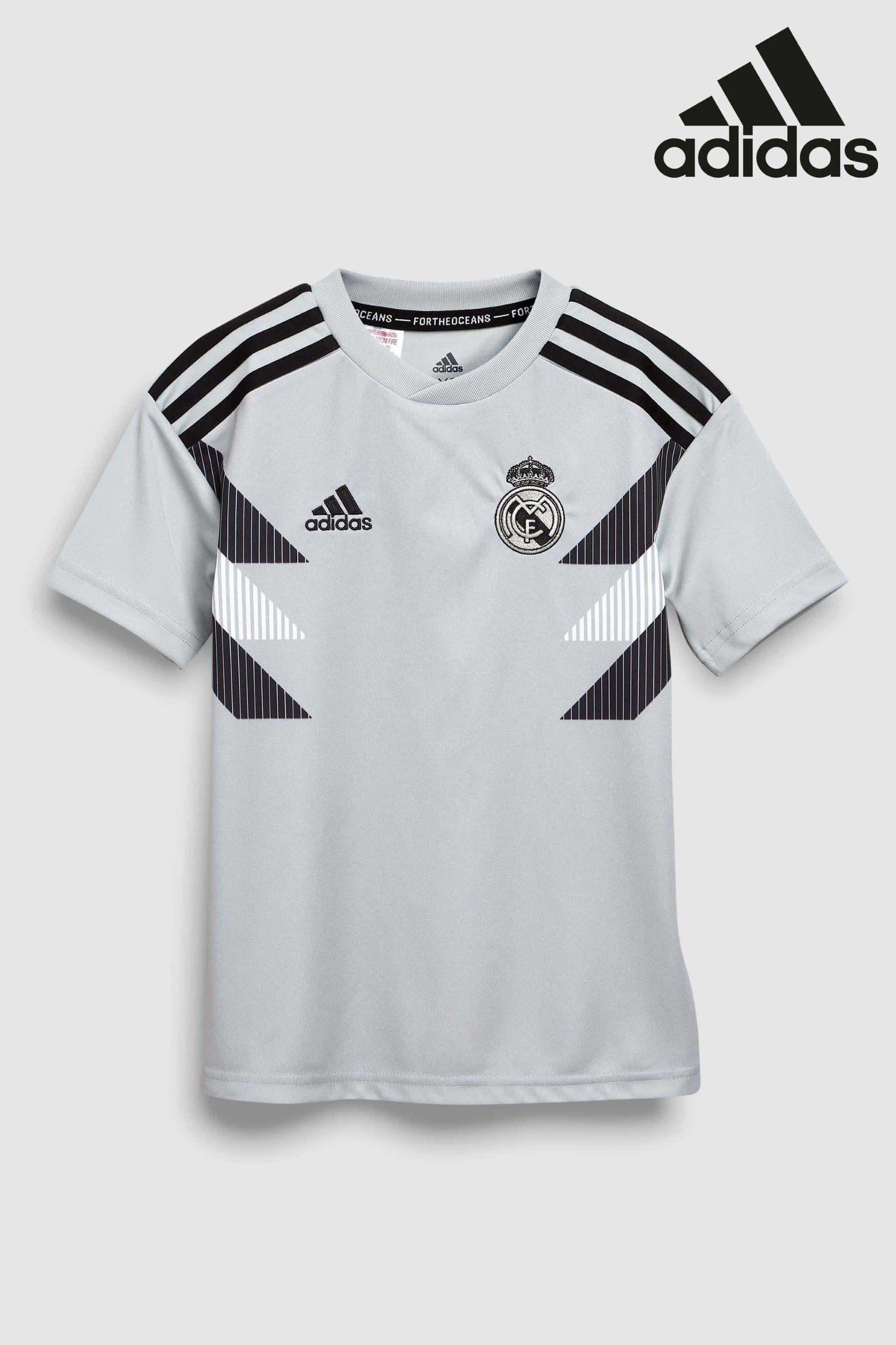 f9ebb9a4e Boys adidas Real Madrid 2018/19 Kids Pre-Match Jersey - White ...