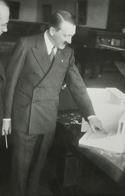 Stripe black suit with polka dot tie, late 1938 in the Great Hall of the Berghof, Adolf Wagner and Boulder nearby. In private, Adolf Wagner (Gauleiter of Munich) was one of the few people who actually addressed Hitler by his first name.