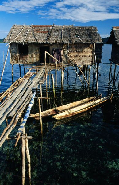 Over Water Bajau House On Stilts And Dugout Canoes. (Greg Elms)