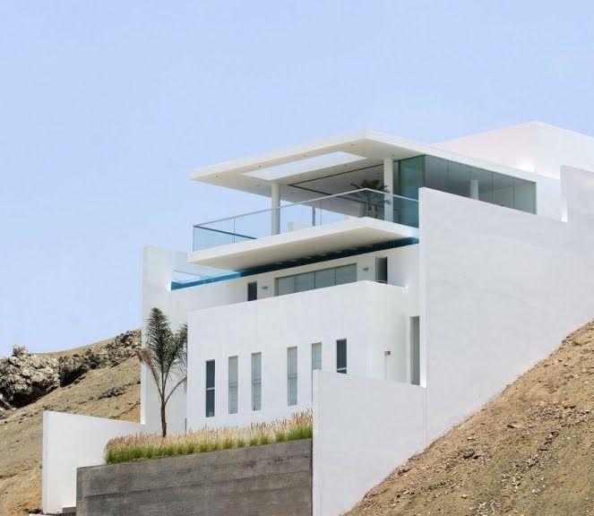 planos de casas modernas a desnivel