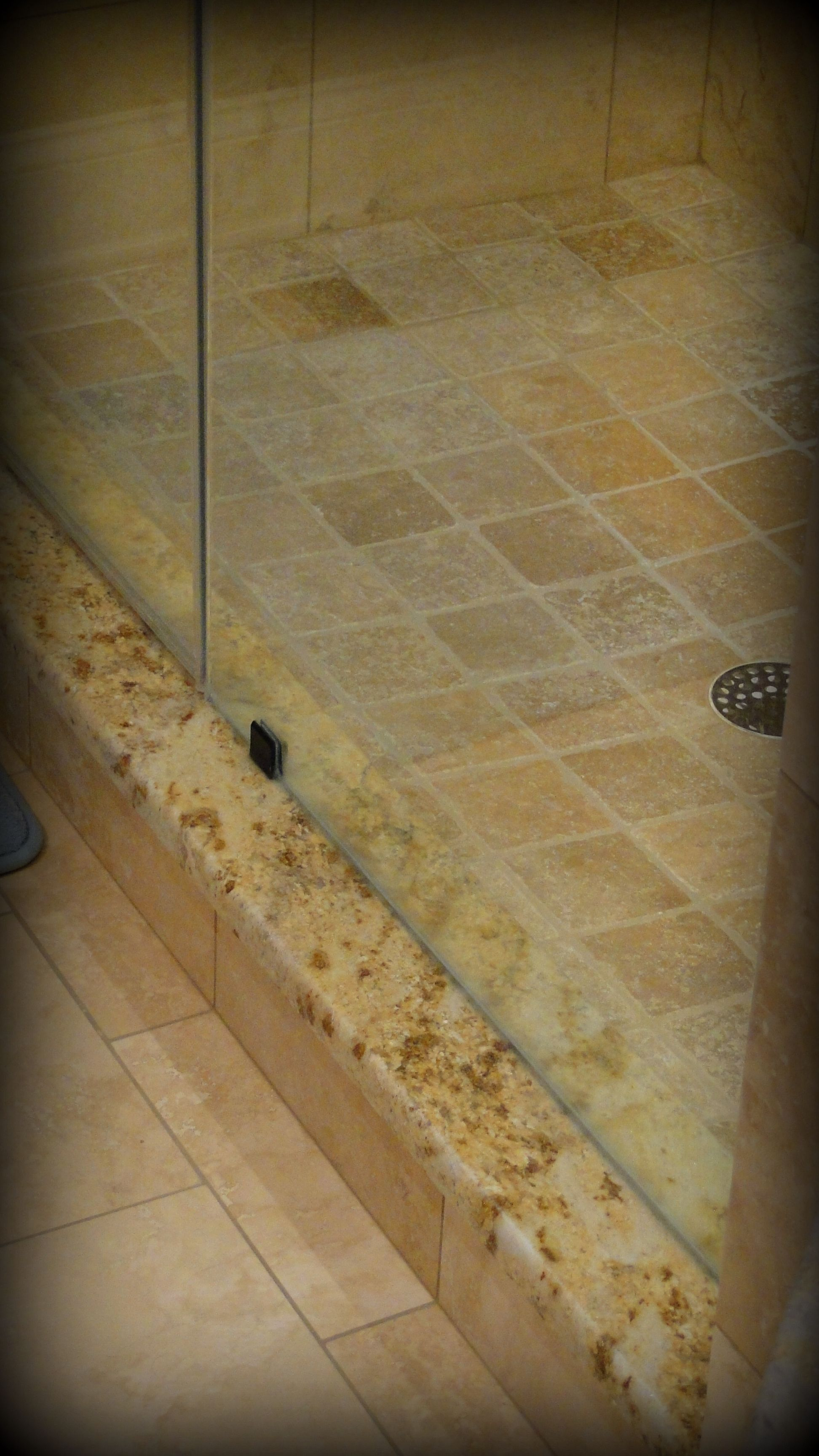 Bathroom Makeover Granite granite curb for the master shower. tumbled marble 4 x 4's on the