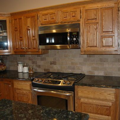 Glass Tile Backsplash With Oak Cabinets Google Search Kitchen Tile Backsplash With Oak Trendy Kitchen Backsplash Kitchen Remodel Countertops