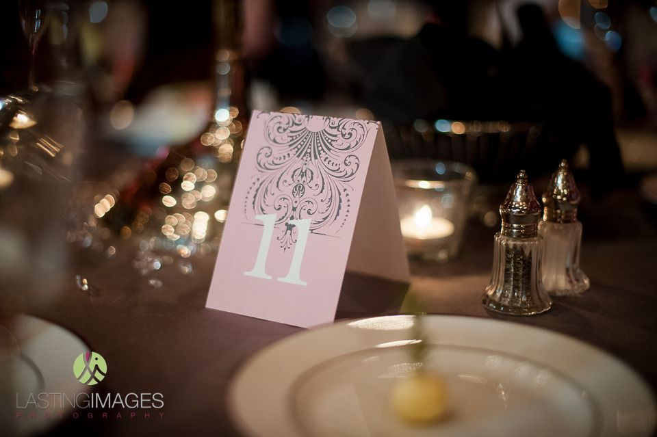 Table numbers in a fun light pink color with a contrasting gray pattern | villasiena.cc