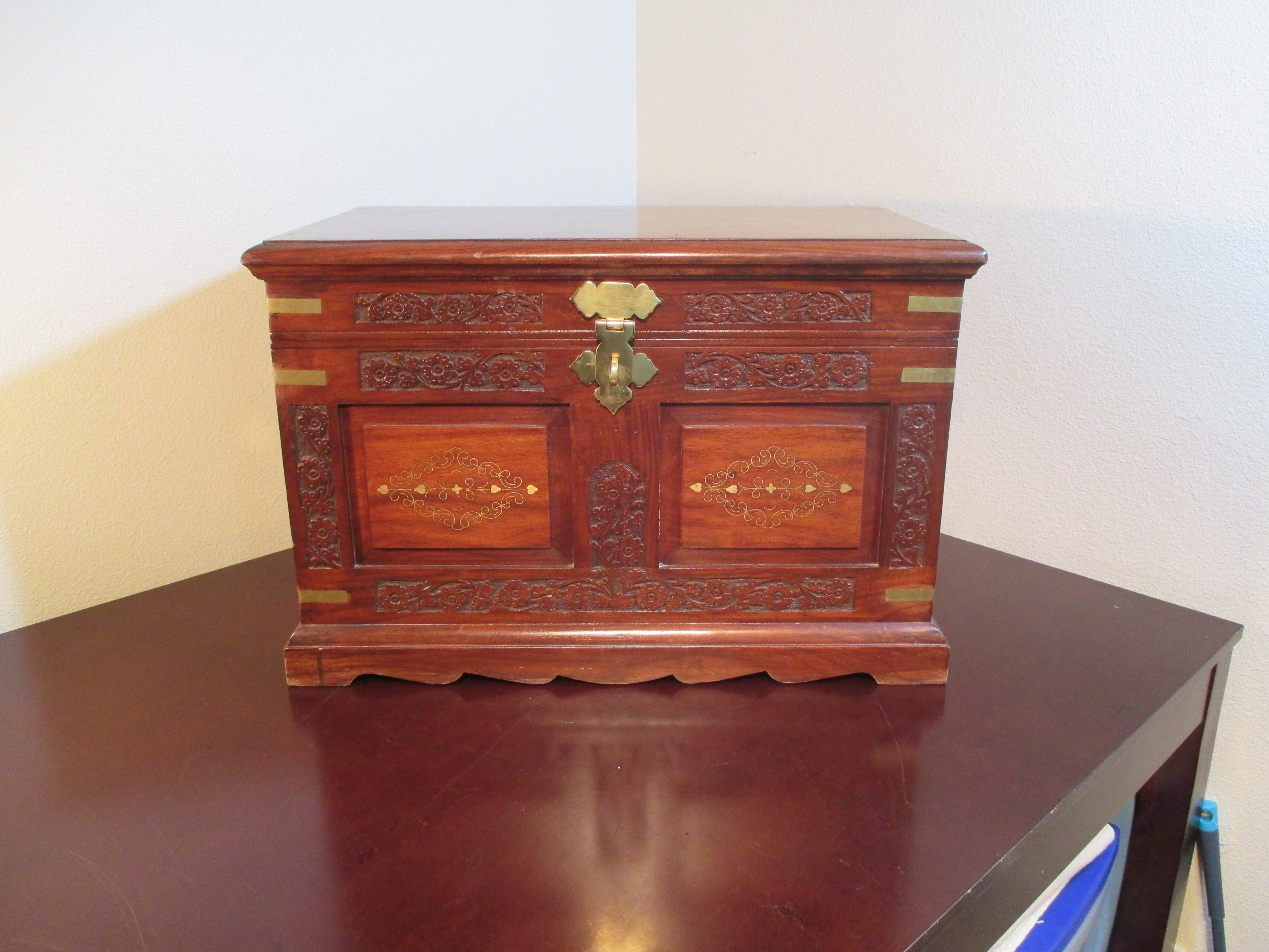 """Always wanted a safe for those memory sakes but never found one that fits you, and your personality. Well, we might just have the one for you! This handcrafted rosewood chest has traveled from the far Middle East just to find itself nice and snug in your lovely home! 16"""" H x 24 1/4"""" W x 14 3/8"""" L  Shipping available upon request"""