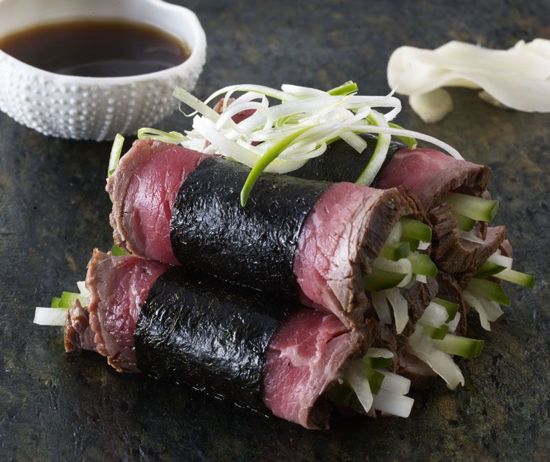 Rolled beef sashimi with onions and teriyaki dip canape ...