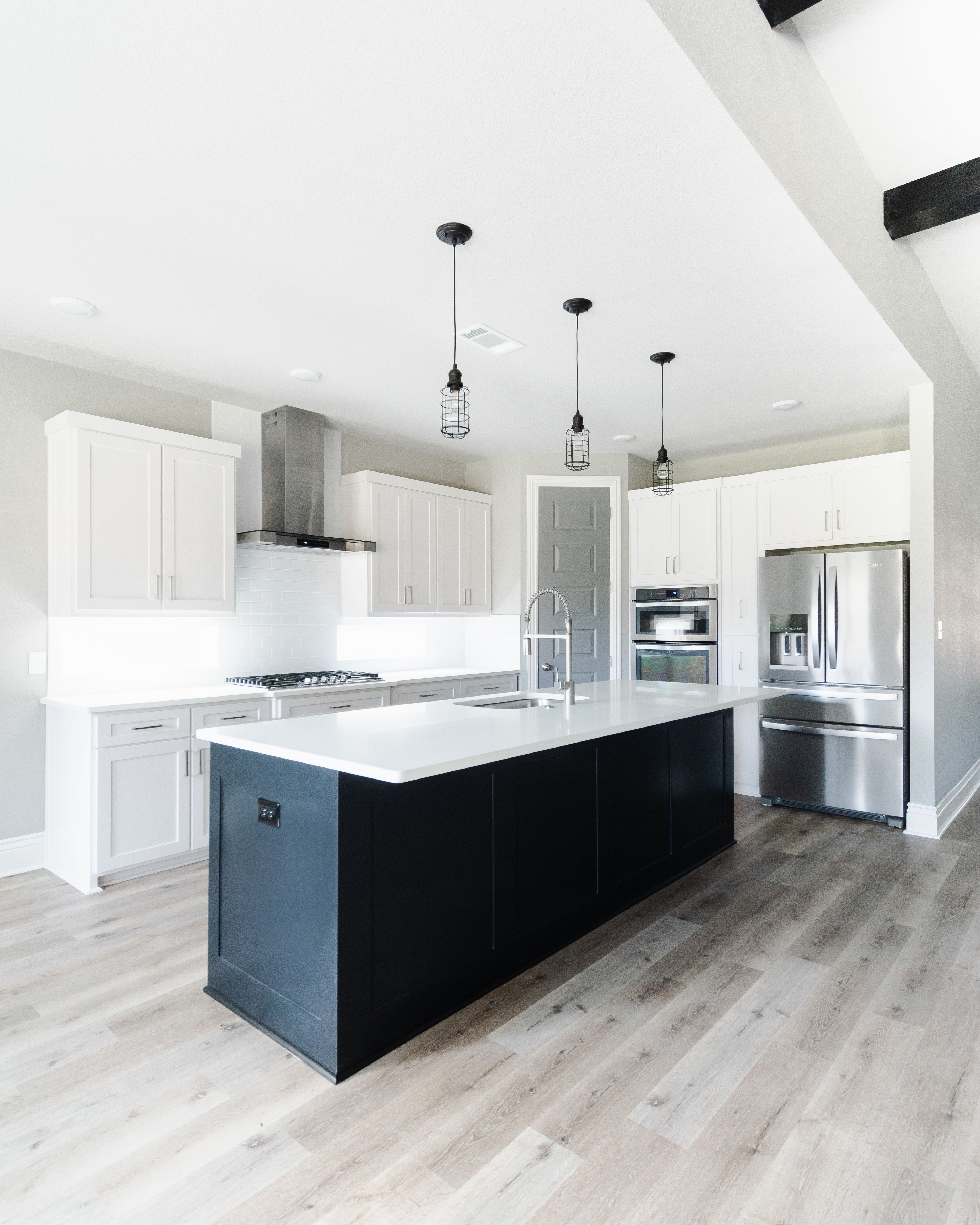 Modern Industrial White Kitchen With Black Island White Modern Kitchen Interior Design Kitchen Kitchen Design