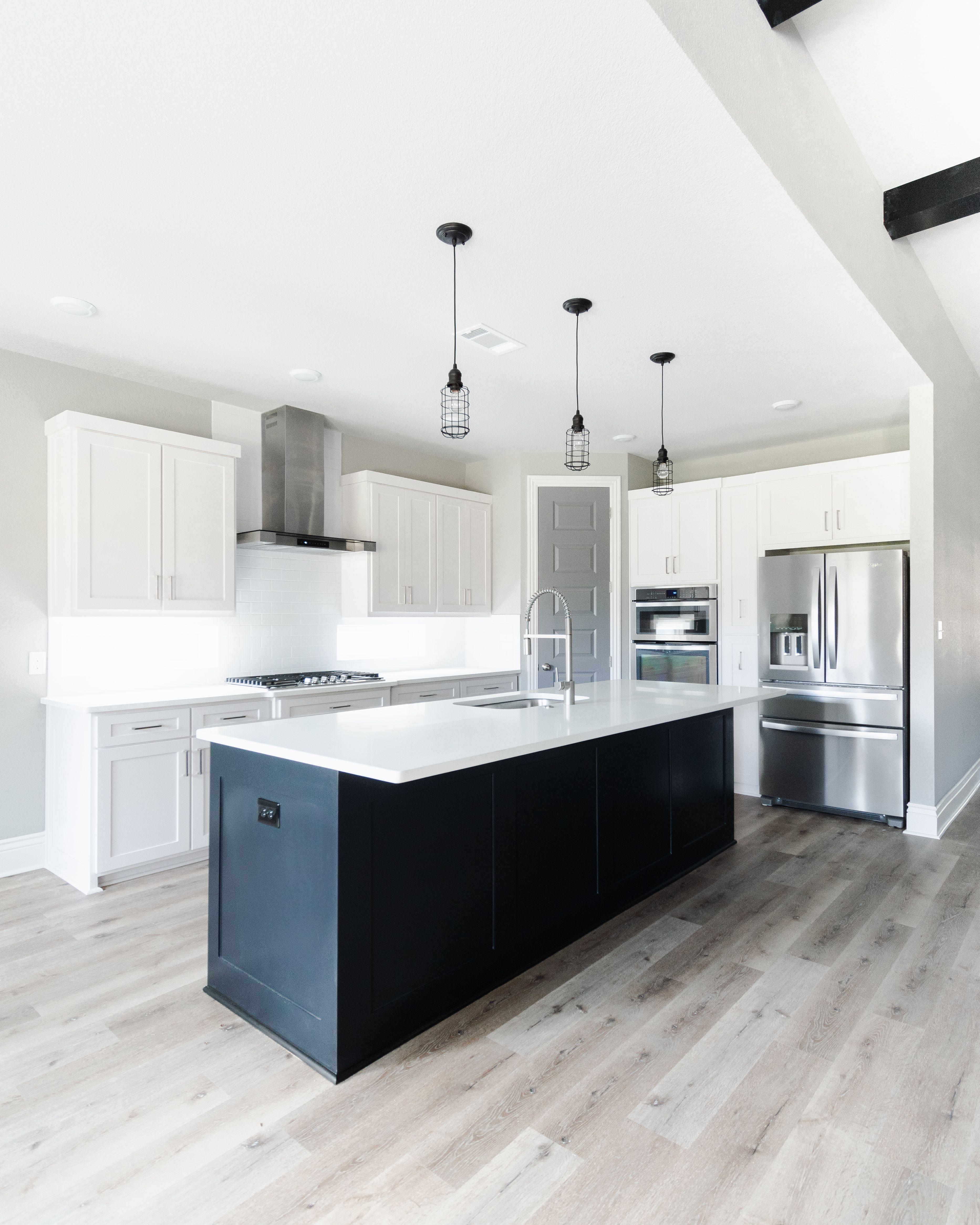 Modern Industrial White Kitchen With Black Island White Modern Kitchen White Kitchen Black Kitchen Island