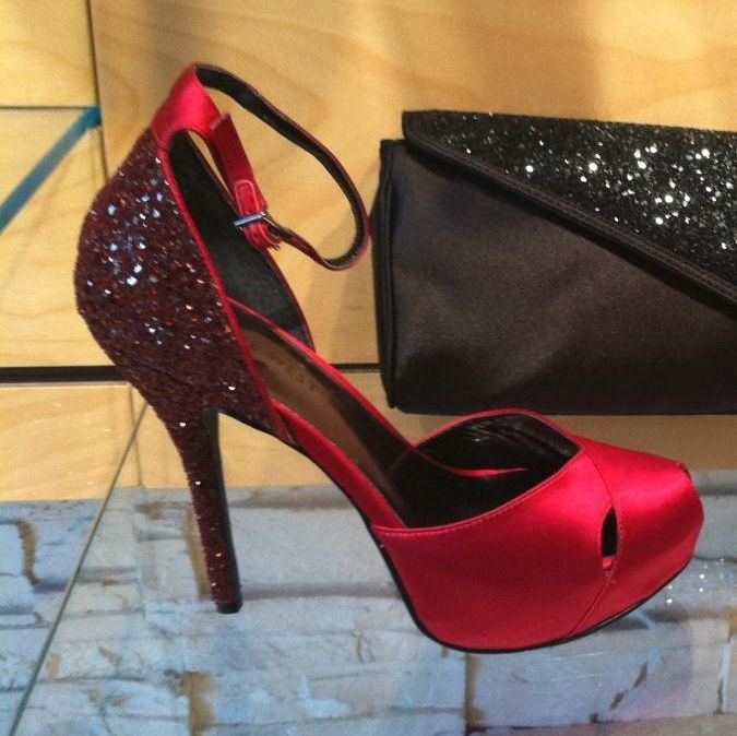 Step into your holiday party by making a sparkling statement with these red shoes from Nine West @CityPlace, complete with a glitter-ifed heel, $89.