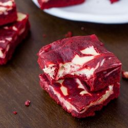 A 30 minute homemade Red Velvet Cheesecake Swirl Brownie recipe that is easy to make and even better to eat!