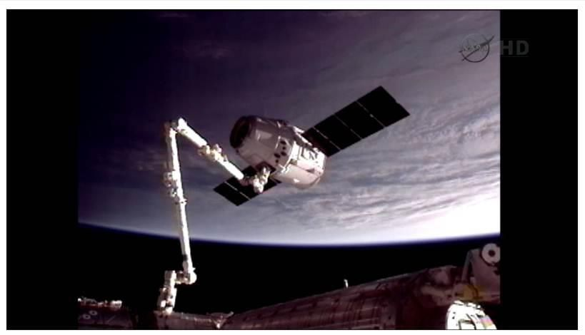 Today in History: The first commercial spacecraft, SpaceX Dragon, berthed with the ISS on May 25, 2012. It's also the first American craft to visit the ISS since space shuttle Atlantis. [IMAGE: NASA - Dragon grappled by Astronaut Don Pettit using CanadArm2 (SSRMS).]