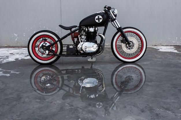 Yamaha bobber. red rims/wheels, white walls