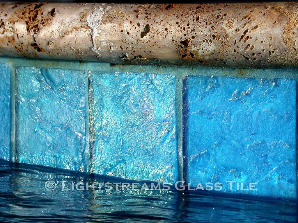 Water line pool tile glass tiles form the waterline tile for american manufactured lightstreams glass tile can be used in both commercial and residential swimming pool waterline projects doublecrazyfo Image collections
