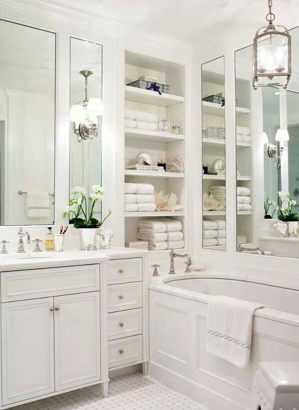 This Beautiful White Bathroom Design Has Used Tall Mirrors To