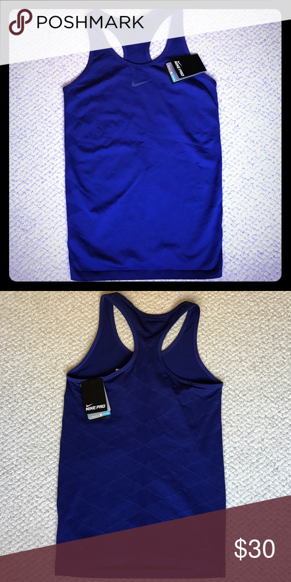 NIKE PRO Hypercool LIMITLESS Running Tank Top Racerback Style Solid Purple with Dark Gray Nike Logo Very Comfortable 80% Nylon 16% Polyester 4% Spandex Material Very nice blend offers durability and stretch for a perfect fit! Perforated like design on back and shoulders to allow your skin to breathe. Nike Tops Tank Tops
