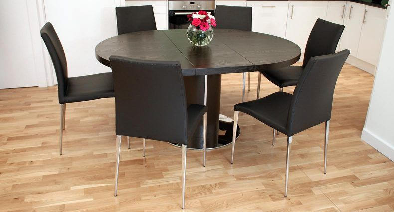 the curva wenge and elise extending dining set has a elegant round