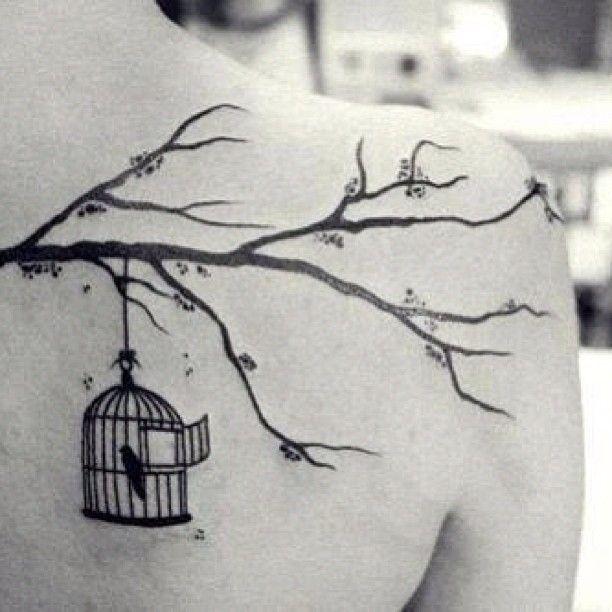 Tree branch and birdcage shoulder blade tattoo,  Go To www.likegossip.com to get more Gossip News!