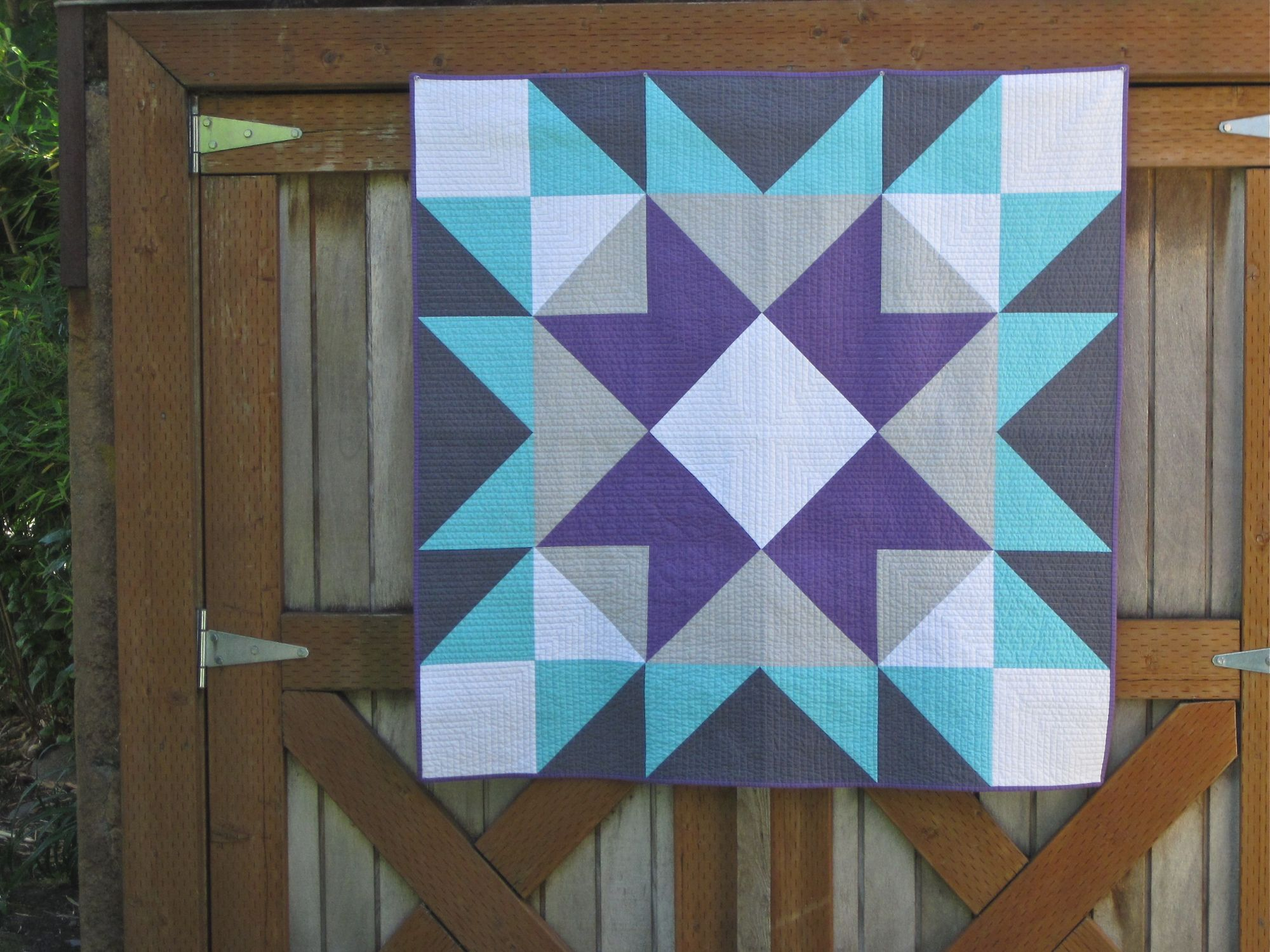 sewkatiedid/Barn Star Quilt: modernizing a traditional block by making it large and in solids...I like this! There are also some good ideas for backing.