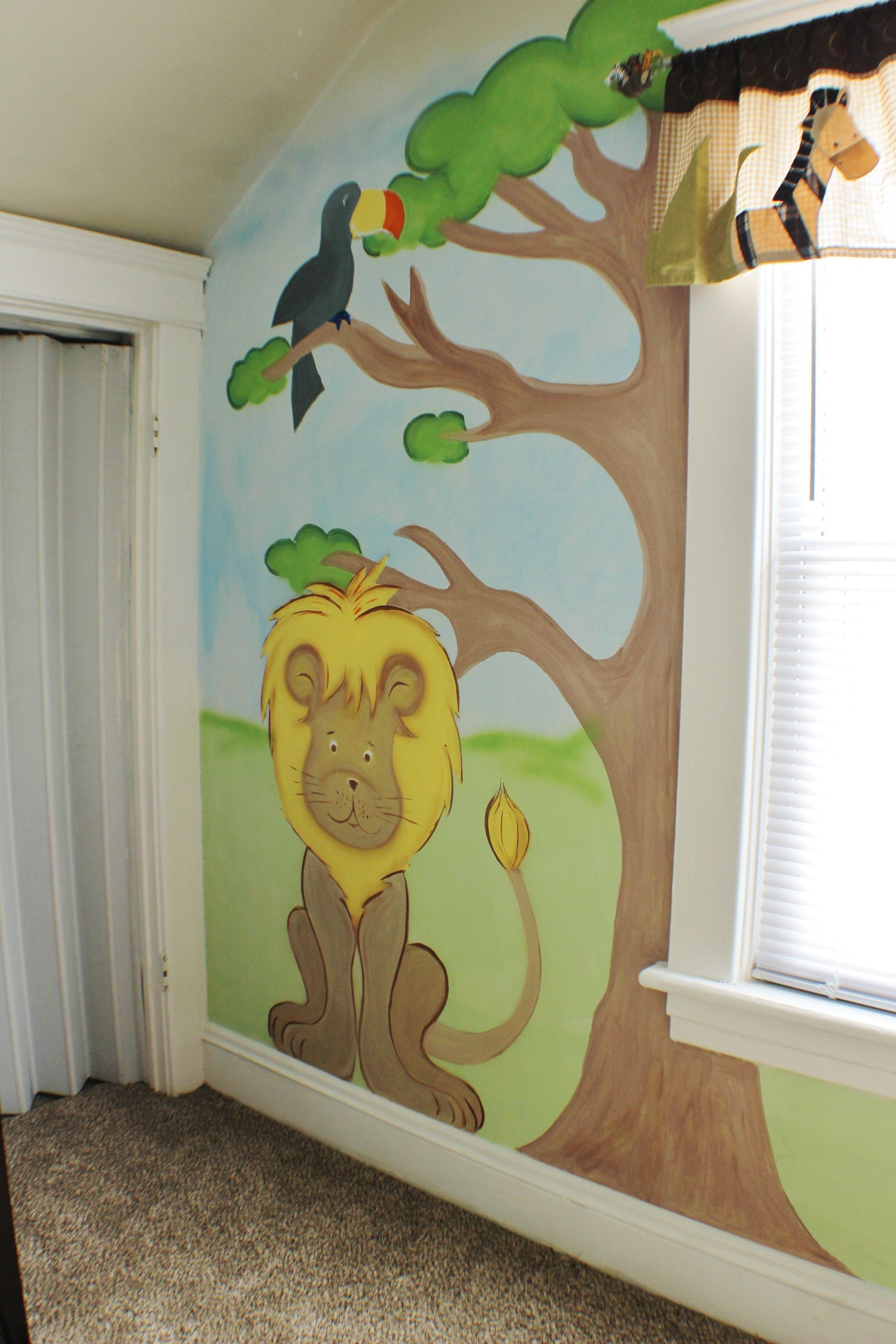 Hand painted lion on bedroom wall.