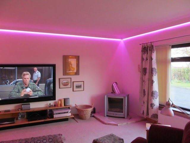 modern false ceiling led lights: living room with pink LED lighting ...