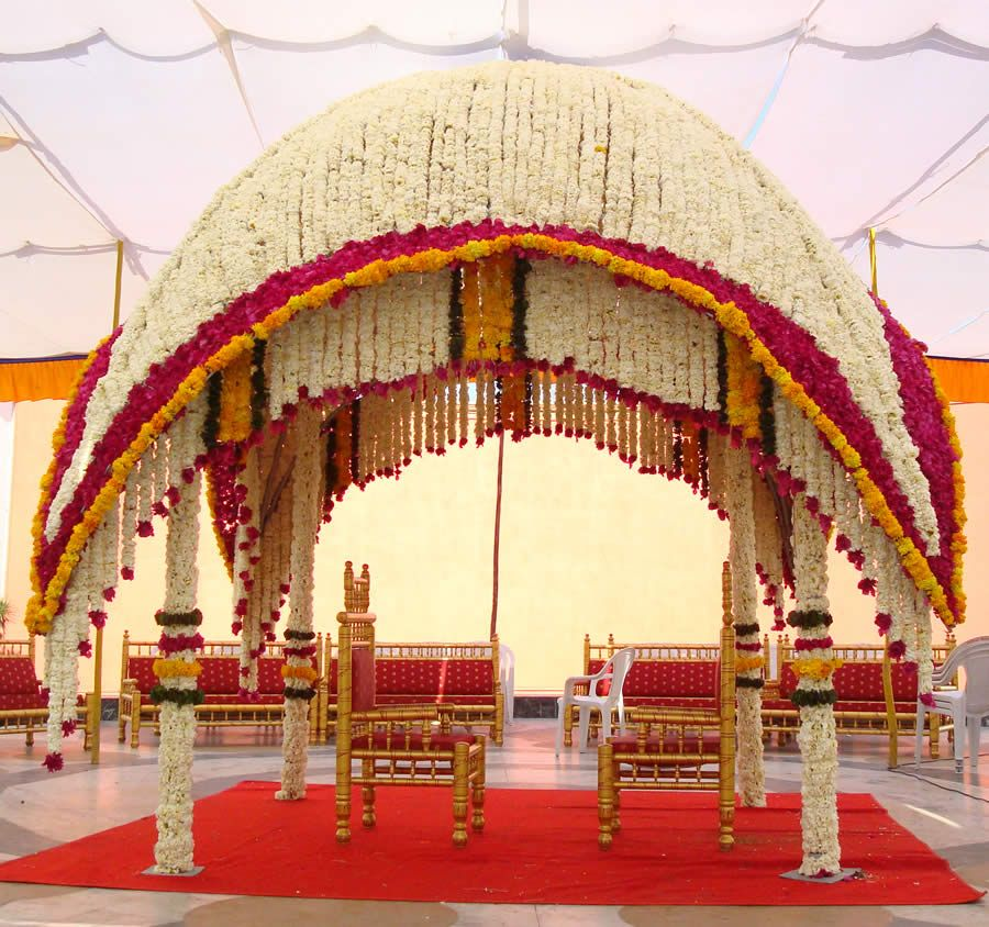 Wedding Decoration Ideas Full Flower Decorations With Curved Tent And Two Small Chars In Outdoor