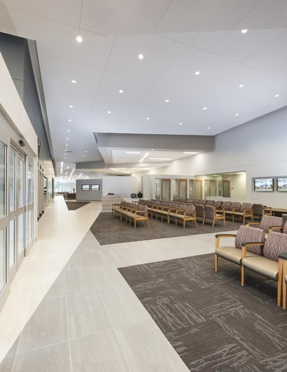 The check-in and consultation stations for pediatrics, women, and infants is separate from the adult waiting area. © 2015 Erika Brown Edwards