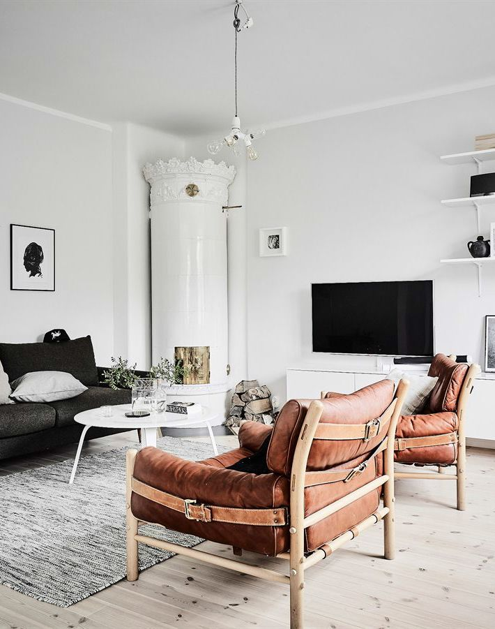 tan leather chairs in monochrome living room