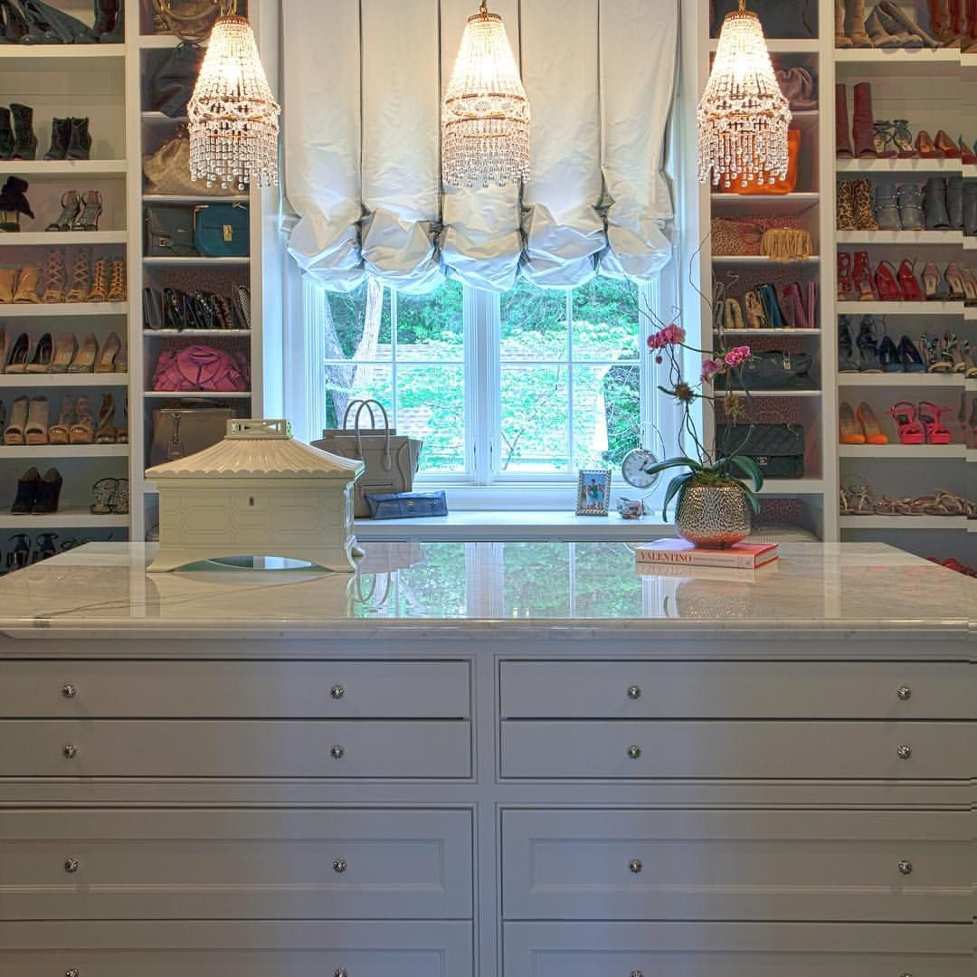 A Large Island And Fun Crystal Chandeliers Really Make This Closet