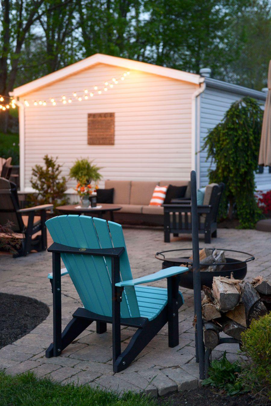 Poly Aruba Blue And Black Adirondack Chair Around A Fire