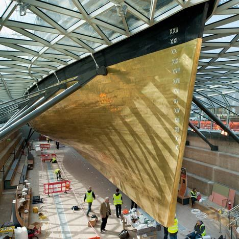 London architects Grimshaw have completed the restoration of historic tea clipper the Cutty Sark, which reopened to the public today in Greenwich.