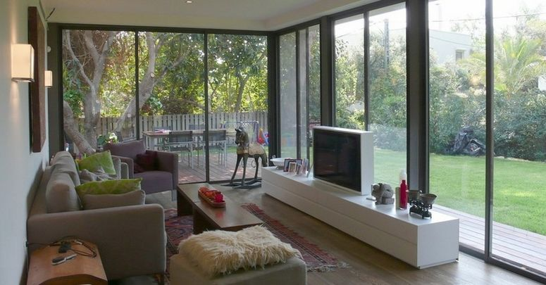 Does It Look Ok To Put A Tv In A Sunroom Modern Family Room Design Modern Family Rooms Living Room Furniture Layout