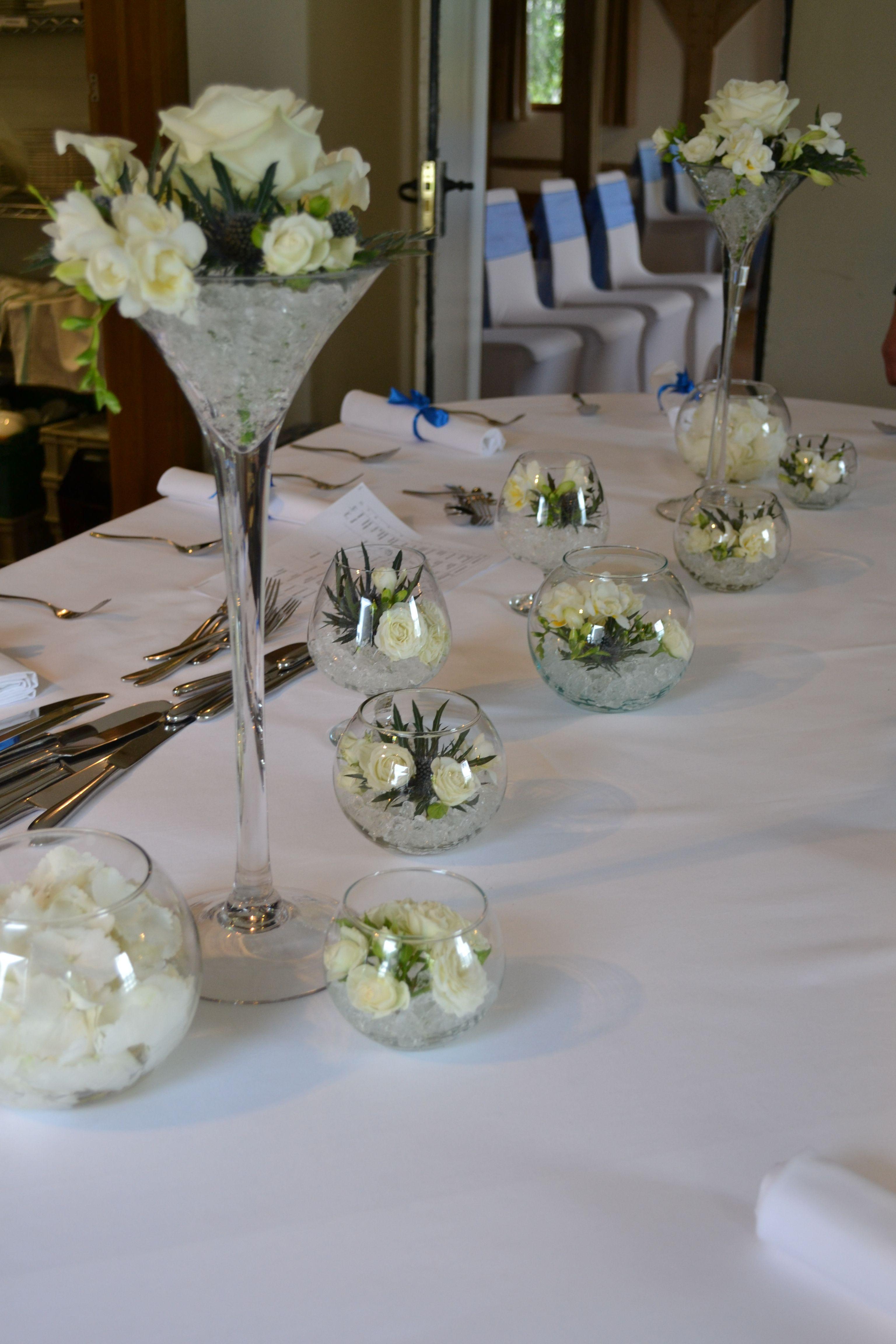 Tall Martini Vases Of White Roses White Calla Lily White Freesia