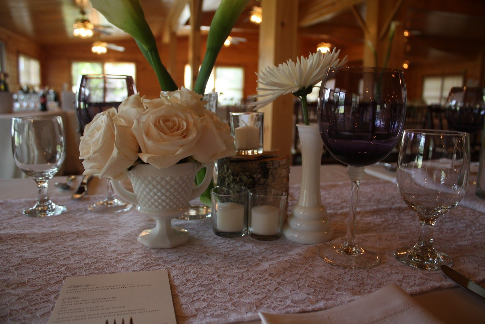 Table Setup Idea, mason jars as glasses and formal vase as the center piece and the picture frame with the guests names (seating) at each table.