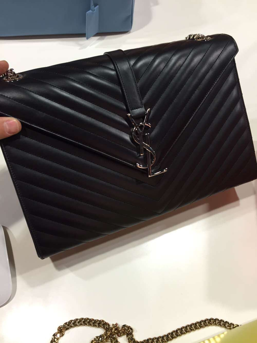 8a87a575acb8 The new ysl monogram clutch will hit the shops in summer and will surely be  producing a buzz in a society of handbag lovers. It s packed completely of  ...