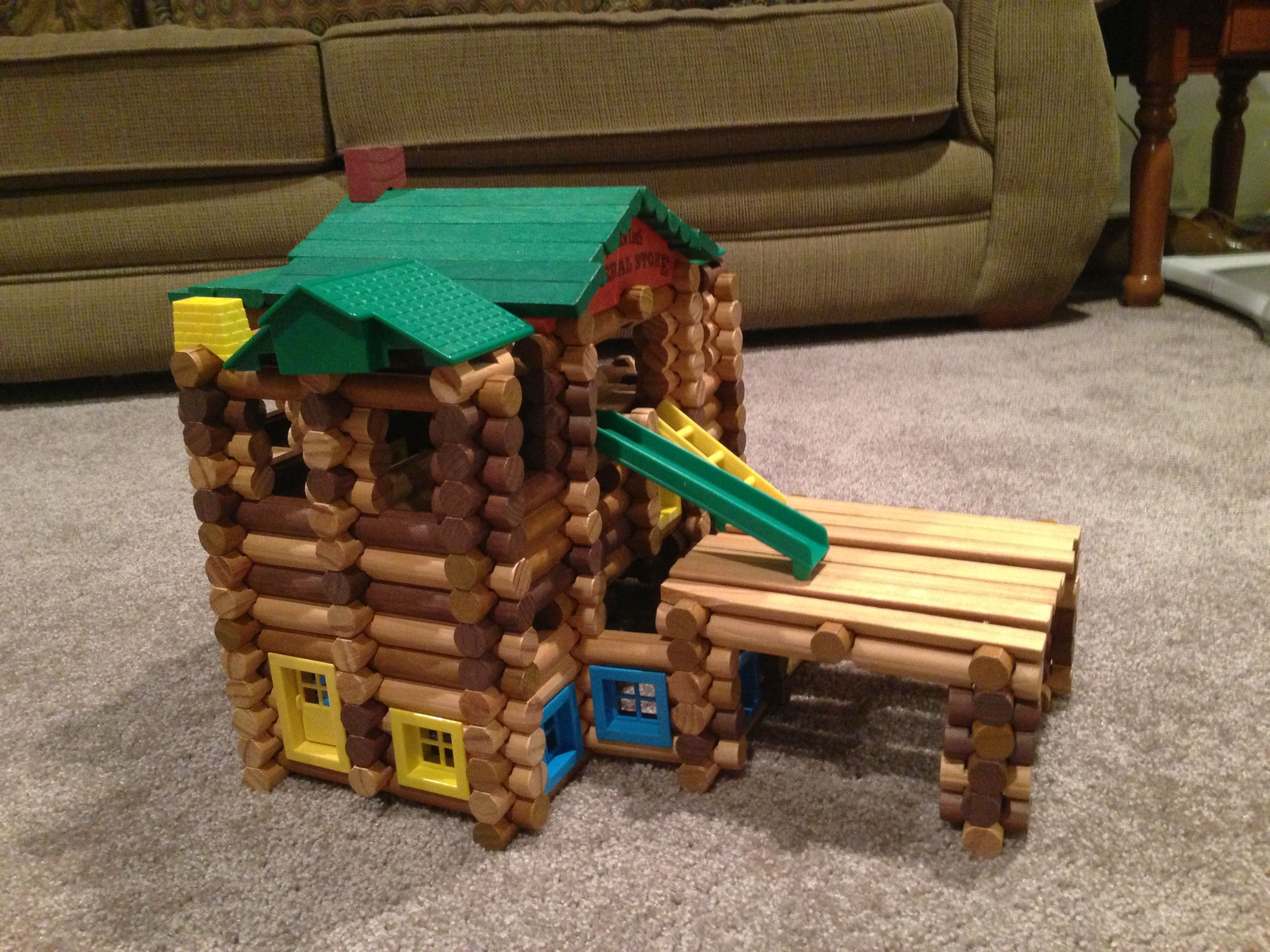Lincoln Log Cabin with a Deck over the Garage different