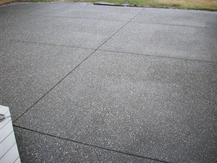 parking assist ideas for garage - Decorative patio Black exposed aggregate finish