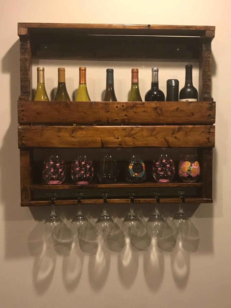 I built this wine rack for a friend using reclaimed pallet