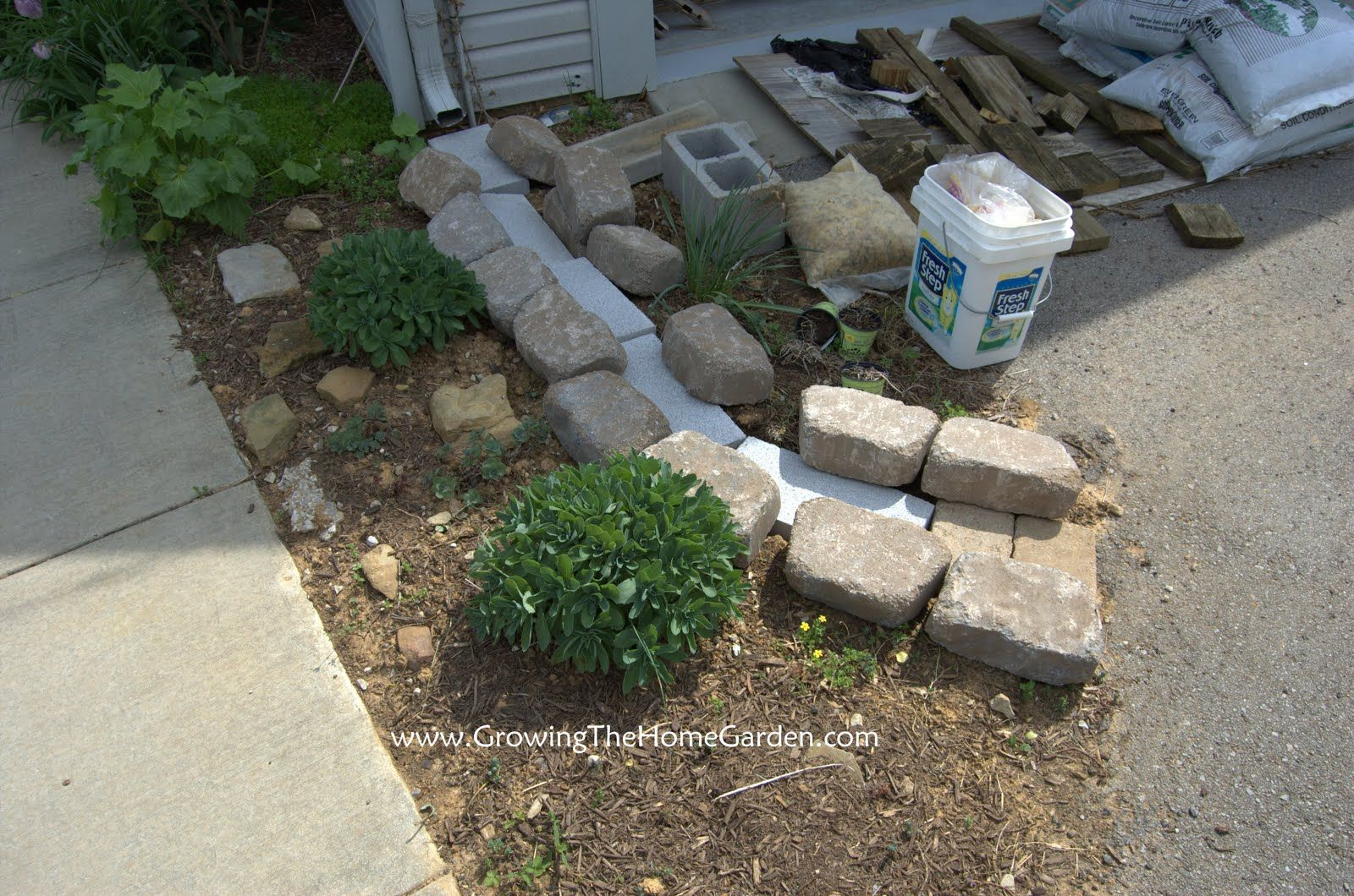 In home garden ideas  Making A Dry Creek Bed Drainage Canal for Downspouts  Growing The