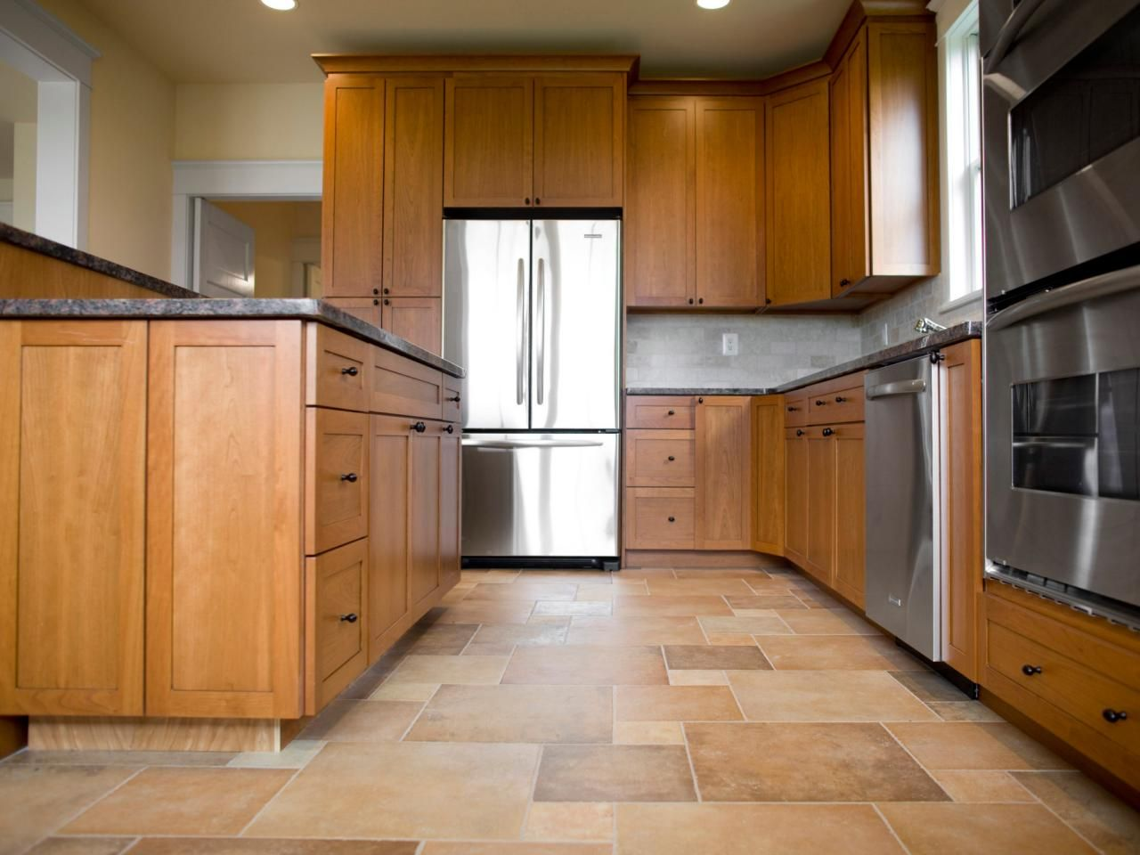 Choose The Best Flooring For Your Kitchen Maple Kitchen Cabinets Best Flooring For Kitchen Kitchen Flooring Options