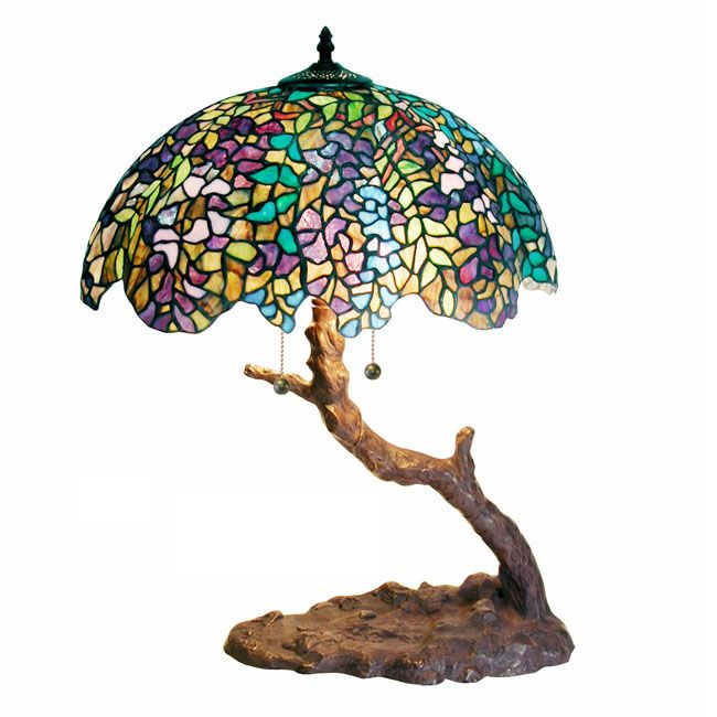 Handcrafted using the same techniques developed by Louis Comfort Tiffany in the early 1900s, this tree accent lamp contains 826