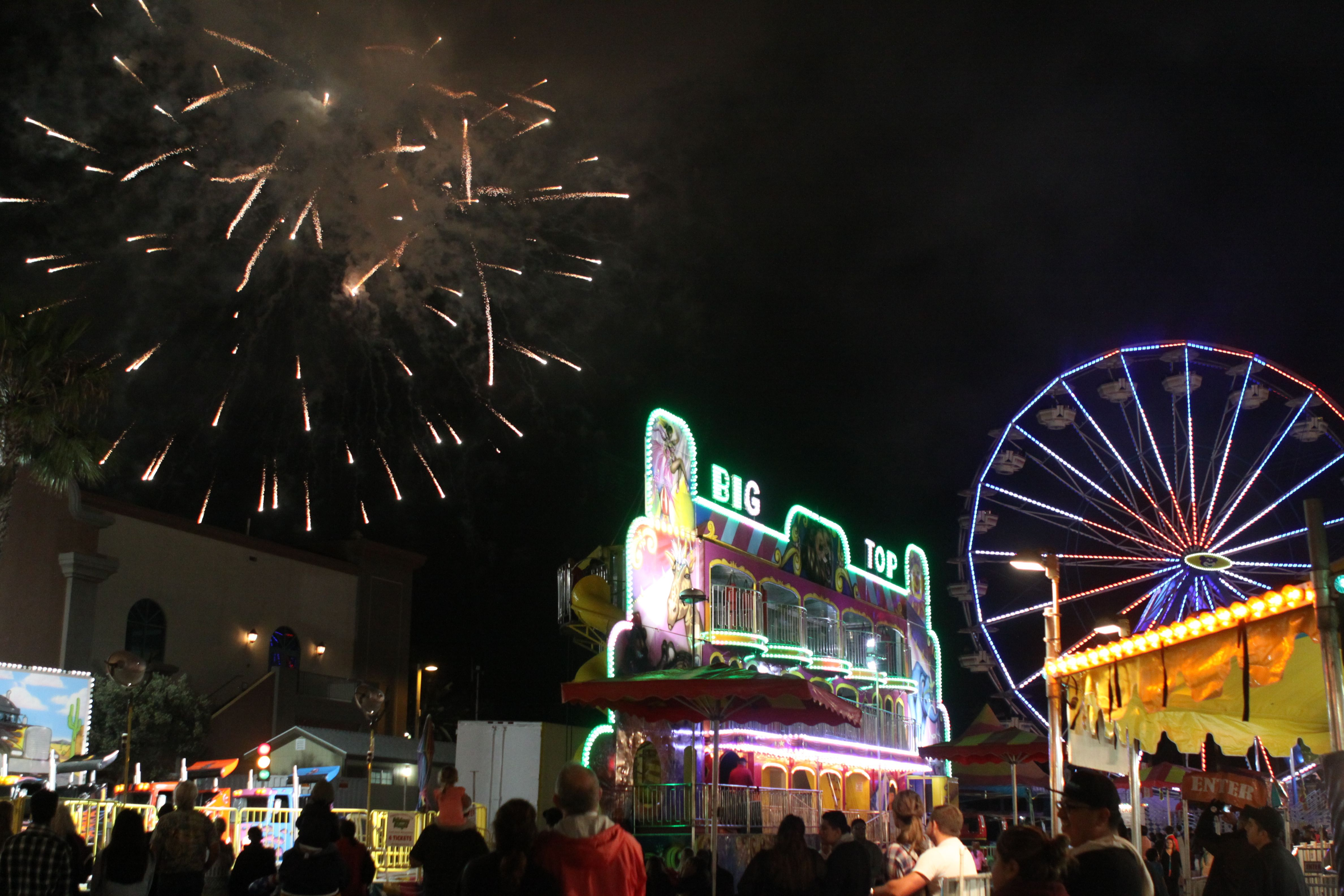 fireworks over the carnival midway at the ventura county fair. 2014