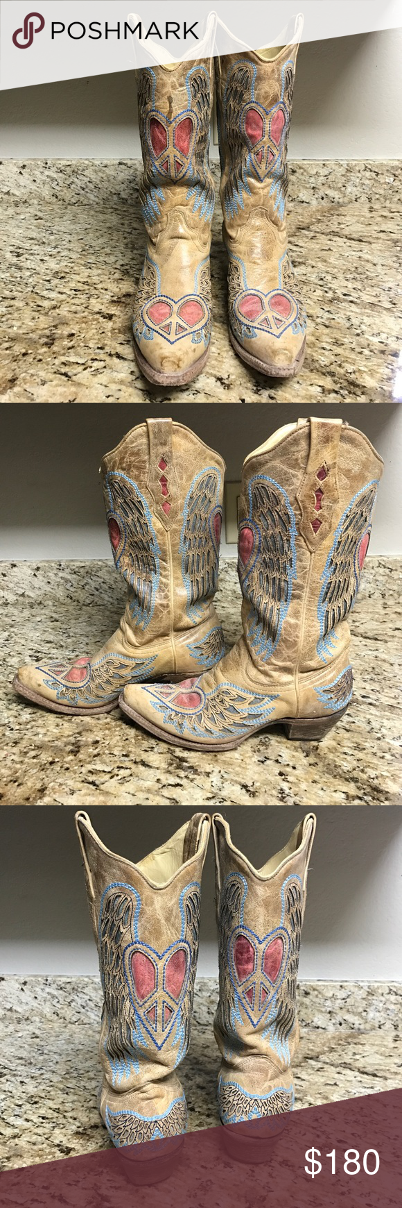 """Corral """"Winged Heart"""" boots. Terrific condition!  There is a boot stain spot on top of right boot - they came that way from store. Worn a handful of times. Such awesome looking boots!!! Corral Shoes"""